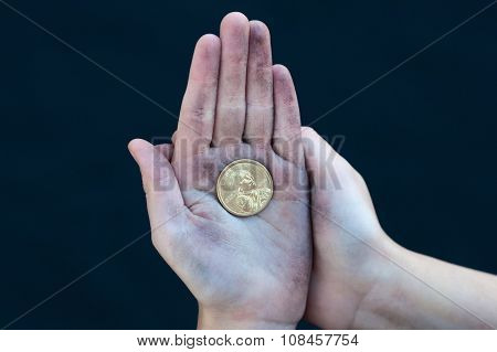 Young Homeless Boy Holds One Dollar Coin