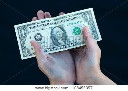 Young Homeless Boy Holds One Dollar