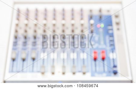 Abstract Blur Photo Of Audio Sound Mixer With Bottons And Sliders.