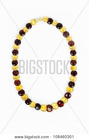 Amber beads close-up on a white background.