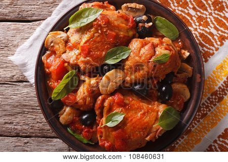 Homemade Cacciatori Chicken On A Plate Close-up. Horizontal Top View