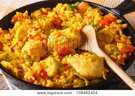 Arroz Con Pollo - Rice With Chicken In A Bowl Pan. Horizontal