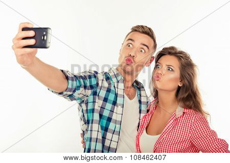 Cheerful Funny Couple In Love Making Selfie Photo With Smartphone
