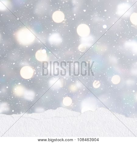 Mounds of snow on a silver Christmas background with stack of presents