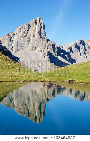 Ansabere Aiguilles reflected in Ansabere Lake. Lescun Cirque. Aspe Valley, Pyrenees, France.