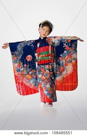 Young Girl In Kimono On White