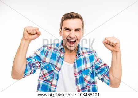 Young Furious Man Shouting And Showing Fists