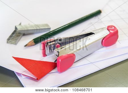 Stapler With Staples Wires On White Paper