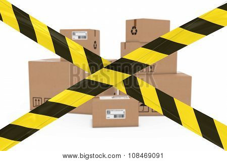 Dangerous Parcels Concept - Stack Of Cardboard Boxes Behind Yellow And Black Striped Barrier Tape