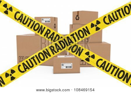 Radioactive Attack Parcels Concept - Stack Of Cardboard Boxes Behind Caution Radiation Tape Cross