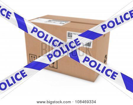 Suspicious Parcel Concept - Cardboard Box Behind Police Tape Cordon