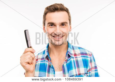 Handsome Young Man Holding A Comb