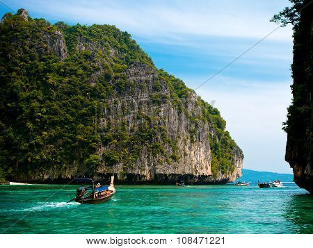 PHI PHI, THAILAND - NOVEMBER 6:  floating boat with tourists on November 6, 2011 in Thailand