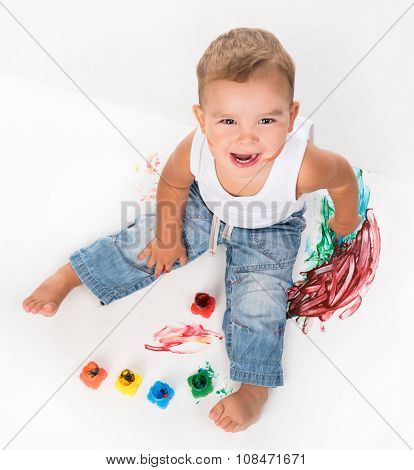 smiling little boy and gouache above photo on white background