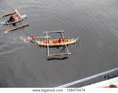 Boys in an Outrigger Canoe