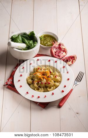 pasta with pesto pomegranate and sliced carrot
