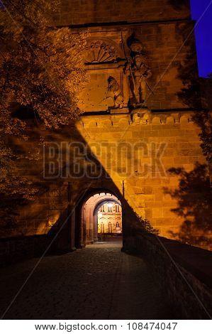 Gates to Schloss Heidelberg with golden lights
