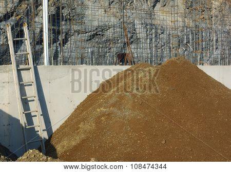 ladder aluminium sandpile concrete wall