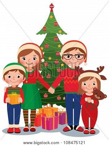 Family At Christmas Tree With Gifts