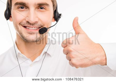 Closeup Photo Of An Agent Consulting Clients On The Phone Gesturing Thumb Up