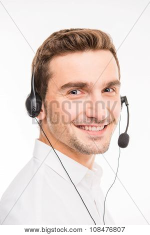Good-looking Agent Consulting Clients On The Phone Smiling