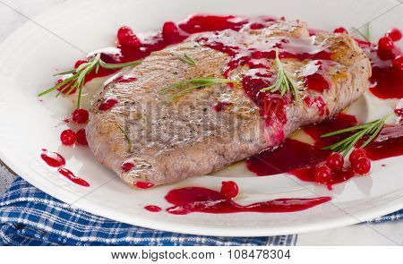 Turkey Breast With Cranberry Sauce On Plate.