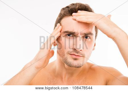 Handsome Disturbed Young Man Touching His Face