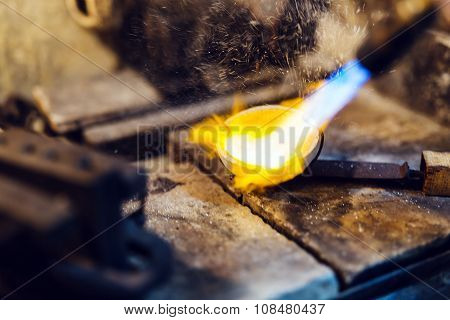 Jeweler Melting Gold
