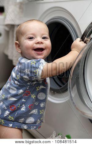 Smiling Baby With Washing Machine