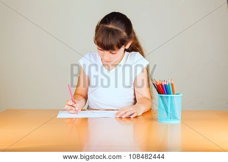 Cute Little Girl With Red Sketch Pen Is Drawing At Kindergarten