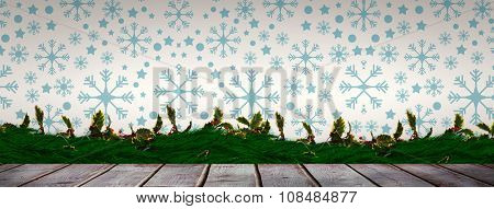 Snowflake pattern against digitally generated grey wooden planks
