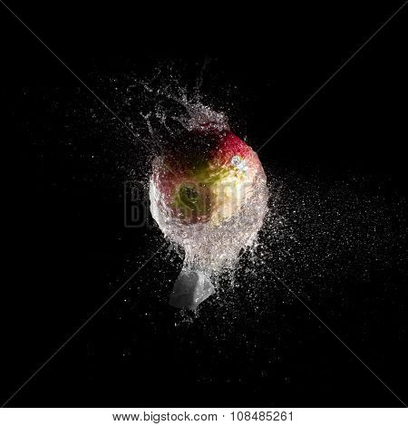red apple inside water balloon