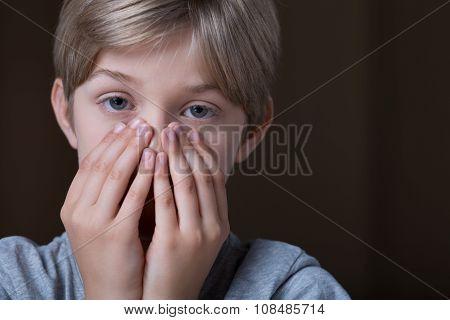 Portrait Of Worried Little Child