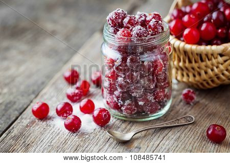 Fresh Ripe Cranberries With Sugar In Glass Jar, Basket With Berries On Background.