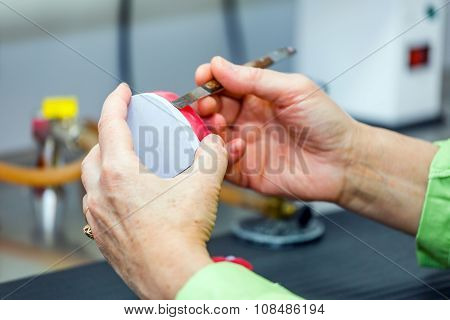Dental technician working in dental laboratory