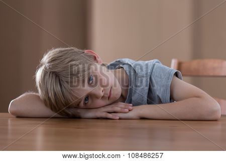 Boy Lying On The Table