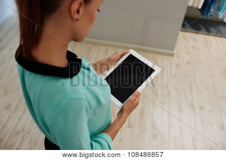 Female worker using digital tablet during work day in hotel