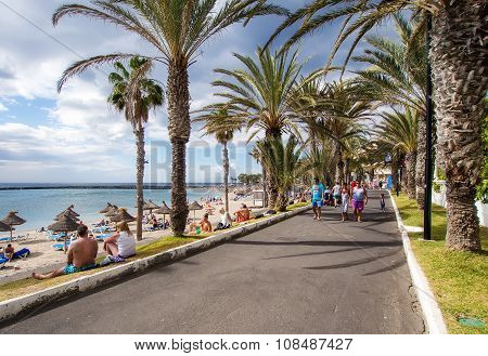 People Walking Along The Las Americas Seafront Promenade