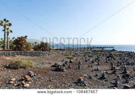 Art Of Stone Balance, Piles Of Stones On The Beach. Costa Adeje In Tenerife, Canary Islands. Spain