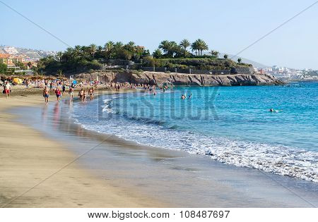 People Relaxing On The Picturesque El Duque Beach