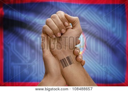 Barcode Id Number On Wrist Of Dark Skinned Person And National Flag On Background - Guam