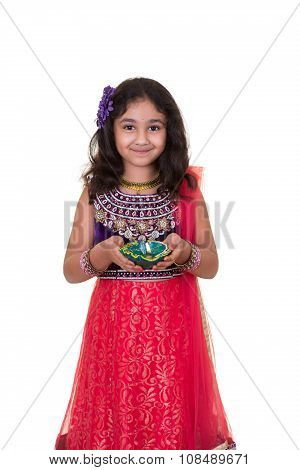 Portrait Of A Little Girl Holding A Lamp, Isolated, White
