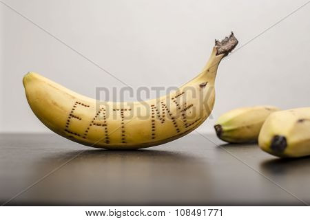 Bananas, On The Peel Of One Of Them Were Written The Words