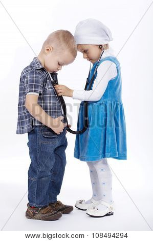 little girl and boy playing with stethoscope