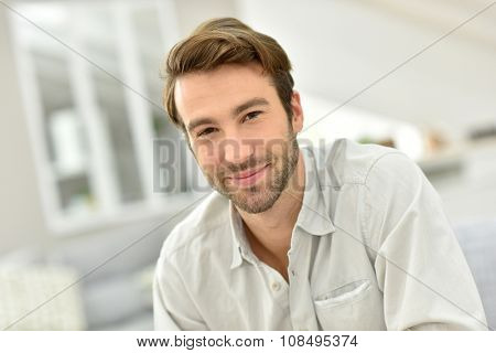 Portrait of handsome man sitting at home
