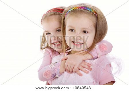 Two little girls - best friends on white