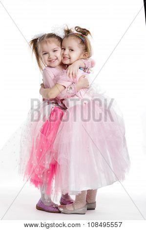 Two little girls - best friends on white