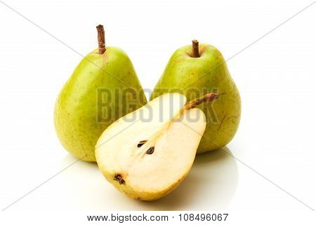 Two green pears and half