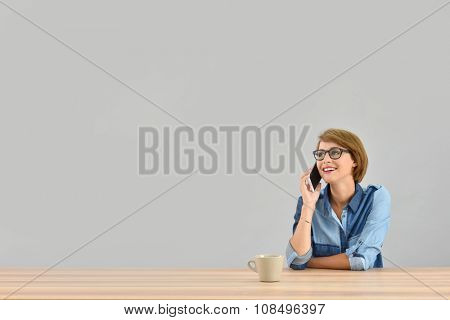 Young woman talking on the phone, isolated