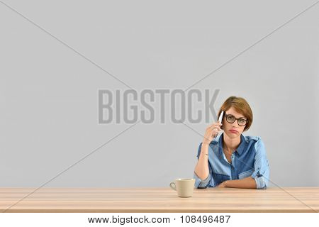 Young woman being annoyed with conversation on the phone